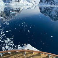 Antarctica Greg Mortimer Aurora Expeditions mirror image from the ship