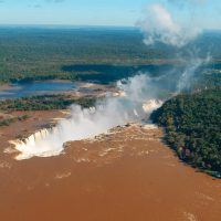 Activity helicoper view of Devil's throat Iguazu Waterfalls Argentina Brazil Alchemy Contours Travel