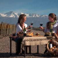 Wine tasting with Andes in the back in Mendoza Argentina Gov Contours Travel