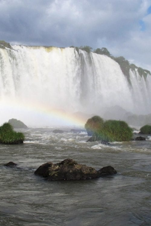 Brazil rainbow in Iguazu Falls Contours Travel