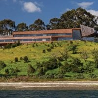 Chile Tierra Chiloe new building from beach Contours Travel