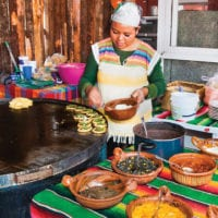 Lady in Mexican kitchen food culinary Mexico Condor Verde shutterstock 360094688 Contours Travel