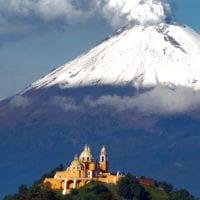 View of church and Popocatepetl Volcano in Puebla Mexico