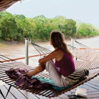 Relaxing Hammock on deck Amazon River Iquitos Peru Delfin Cruise Contours Travel