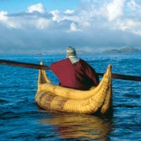 Cultural Uros Reed Islands men in a canoe in Lake Titicaca Puno Peru Condor Contours Travel Contours Travel Titicaca