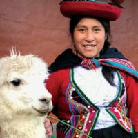 Woman with llama in the streets of Cuzco Peru Diego Curutchet Contours Travel