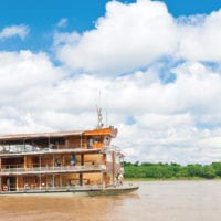 Vessel sailing on the Amazon River Iquitos Peru Delfin Cruise Contours Travel