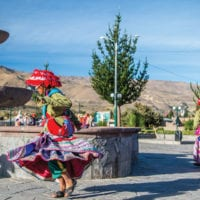 Peru lady dancing in Yanque town near Colca Contours Travel